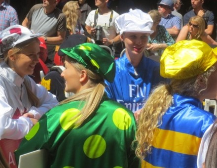 three young women in racing clothes