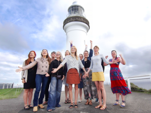 group in front of Byron Bay lighthouse