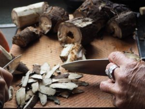 Peeling burdock root