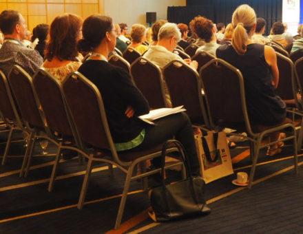 delegates listening to presentation